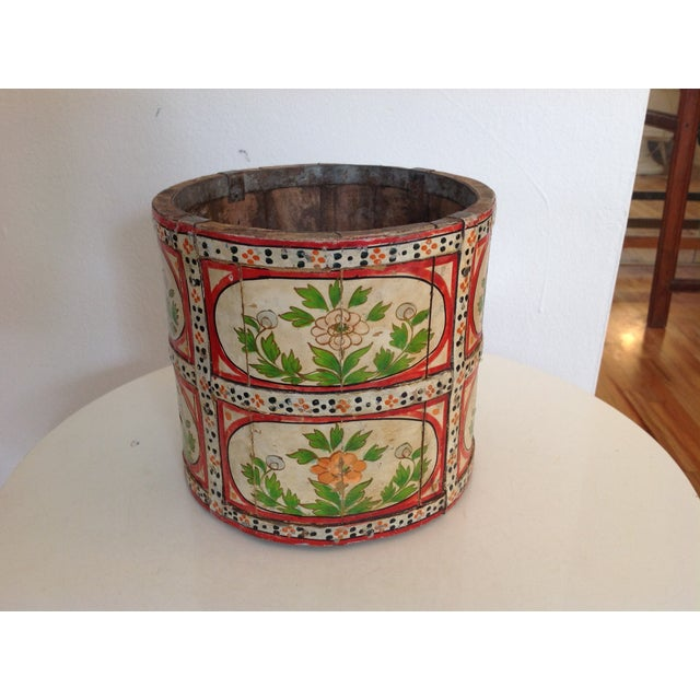 Hand-painted wood pail or vessel with vivid shades of red and green and floral patterns, The vessel is made of multiple...