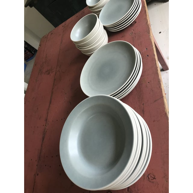 Set of Heath Ceramics plates and bowls from the Coupe Line in the mist/ linen color. 6 dinner plates (10.75 in ) 6 salad...