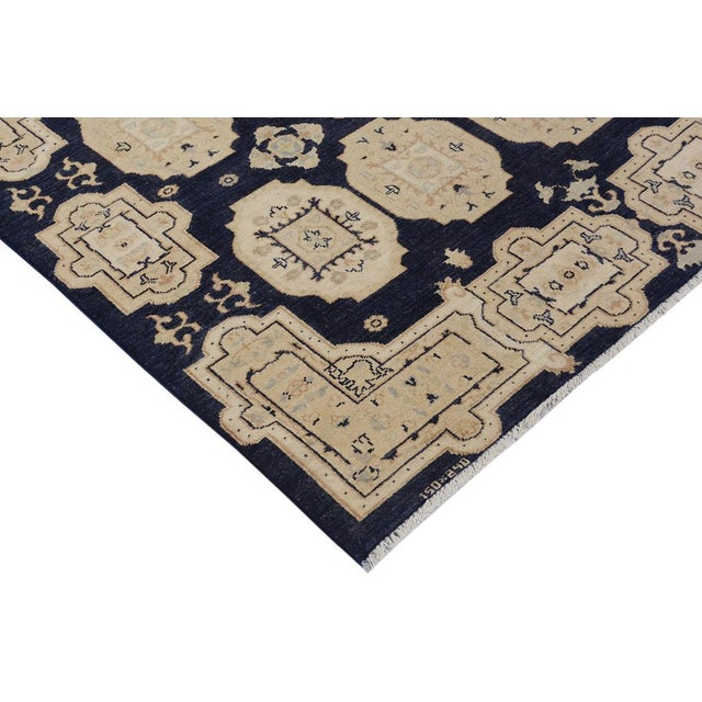 Embellish your home décor with a touch of luxury with this majestic rug hand knotted in the highest quality wool and...