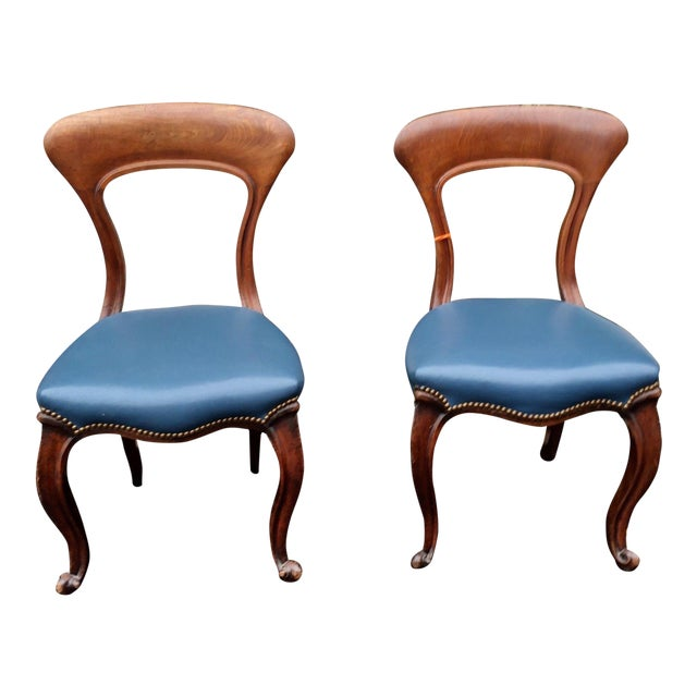 Pair of Stylish Antique Side Chairs w Blue Leather Seats - Image 1 of 5 - Pair Of Stylish Antique Side Chairs W Blue Leather Seats Chairish