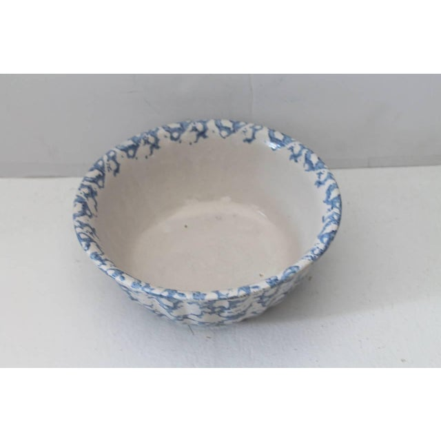 This is a large 19th century sponge ware serving bowl with a fluted rim. The condition is very good.