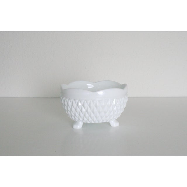 Small white milk glass dish with 3 feet. Perfect on your desk to corral paperclips and whatnots, as a place to hold your...