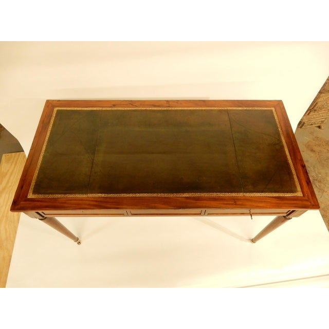 Louis XVI style 19th century writing desk with two drawers and original leather top.