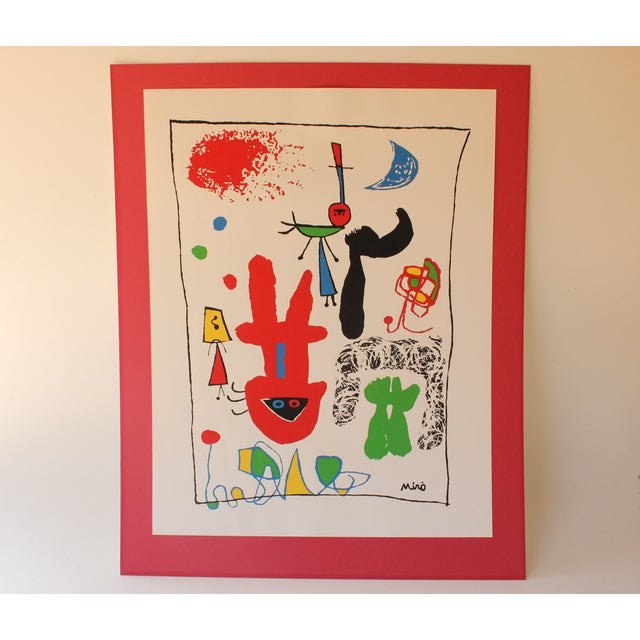 """This vintage serigraph is after Joan Miro's 1948 work, """"Acrobats in the Night Garden."""" It is loosely mounted on red..."""