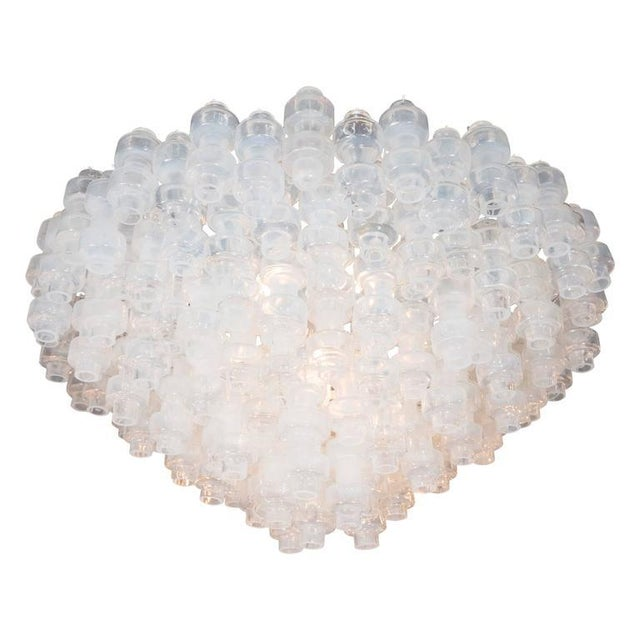 This outstanding Murano glass chandelier in the manner of Carl Fagerlund features an interlocking design consisting of...