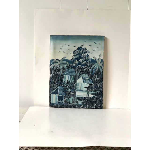 Mid 20th Century oil on canvas painting of an Anglo Indian tropical village scene in hues of blues and whites. Unframed.