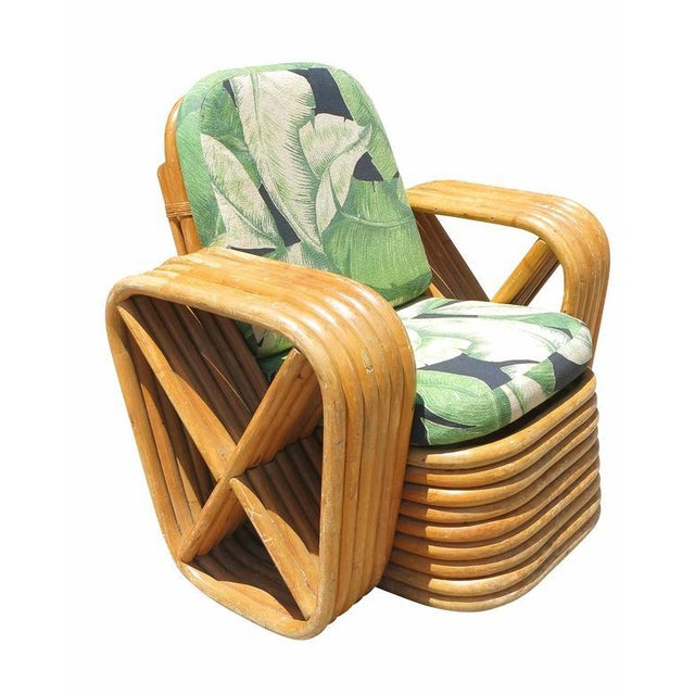 Child size Paul Frankl lounge chair, this chair features six-strand square pretzel arms with a Classic stacked base....
