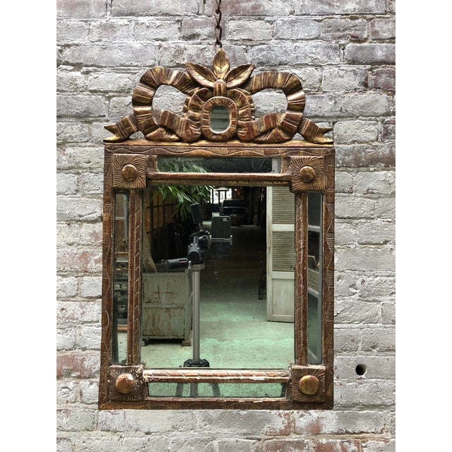 French carved giltwood mirror, Louis XVI This mirror is adorned with floral and foliate patterns. All in the typical Louis...
