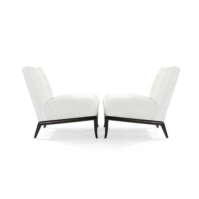 Set of slipper lounge chairs designed by T.H. Robsjohn-Gibbings for Widdicomb, circa 1950s. Base fully restored. Newly...