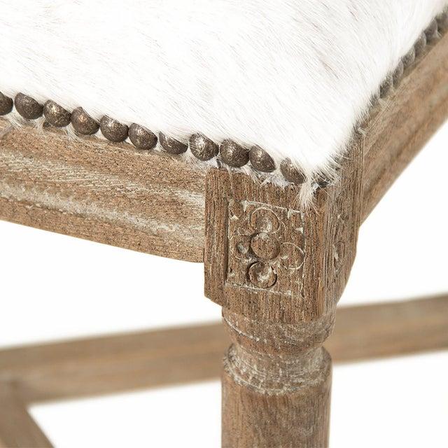 Round back bar stool upholstered in Brazilian white cowhide on limed grey oak frame.