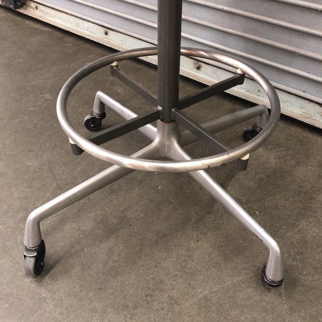 Original Eames for Herman Miller adjustable drafting stool on universal base. Fiberglass shell and original linen (tear as...