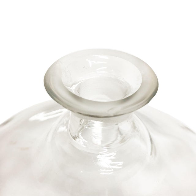 """Beautifully shaped, Mid Century decanter. Chip on the top lip. Age appropriate wear. Measurements: 10""""W x 10""""D x 8""""H"""