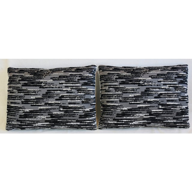 Pair of custom-tailored pillows in unused black and white cut and uncut velvet on a gray cotton fabric background called...