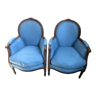 1940s Antique Petite French Blue Upholstery Carved Walnut Frame Fireside Chairs or Bergeres- a Pair For Sale