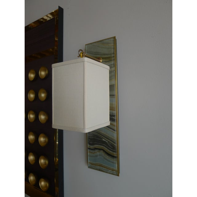Modern Brass and Marbleized Wall Sconce by Paul Marra. Glass over marbleized paper. Brass. Paper shade shown. By order....