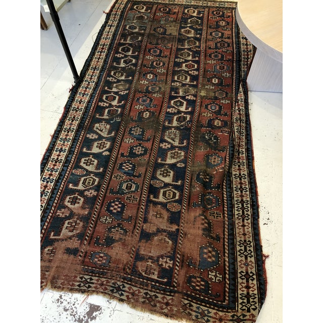 Traditional vintage Caucasian rug, with beautiful geometric patterns. It is beautifully worn and there are a few holes in...
