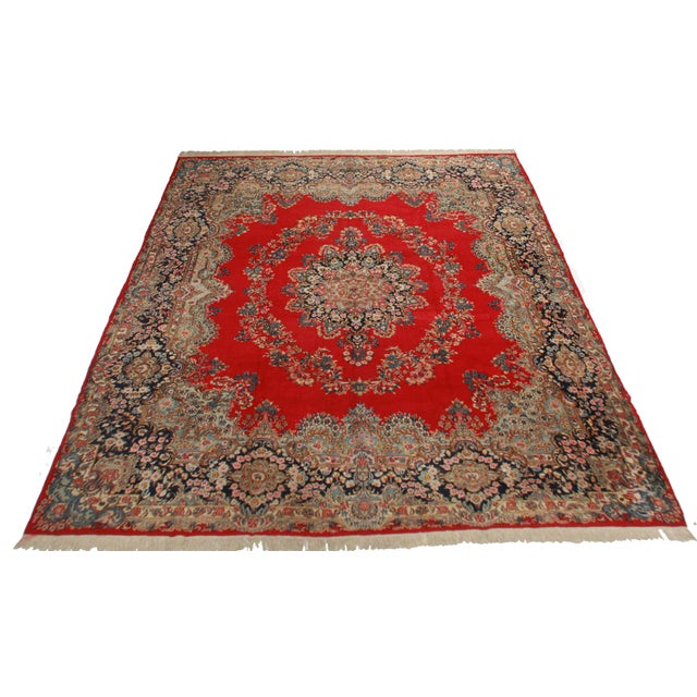 Offered is a vintage hand knotted wool square Persian Kerman rug with a medallion design.