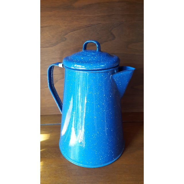 Highly collectible blue enamel tea kettle with age appropriate wear.
