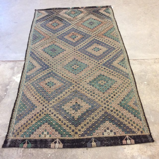 It's time to get on the Kilim kick! This is a great vintage Kilim with a very cool blue green, rust and purplish color...