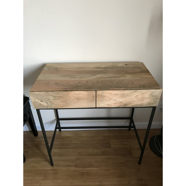 I bought this desk less than a year ago and it is in like-new condition. I am moving overseas and cannot bring it with me....