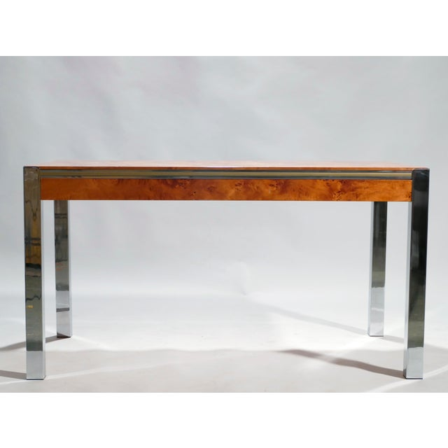 Famed midcentury designer Willy Rizzo often used burl wood in his designs, and it's not hard to see why in this dining...
