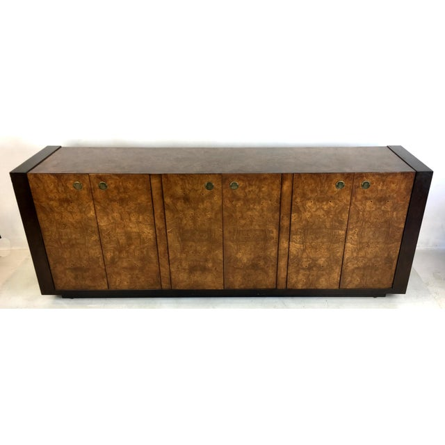 Beautifully crafted mahogany buffet with Carpathian elm burl top and doors with flush brass finger pulls. The dark brown...
