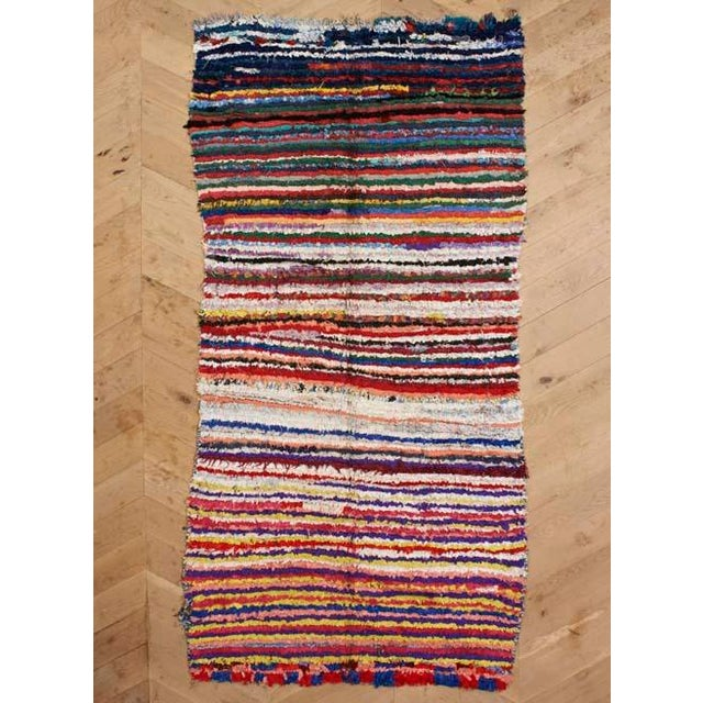 This colorful vintage, one-of-a-kind rug features a truly unique pattern- a conversation piece for sure! This boucherouite...