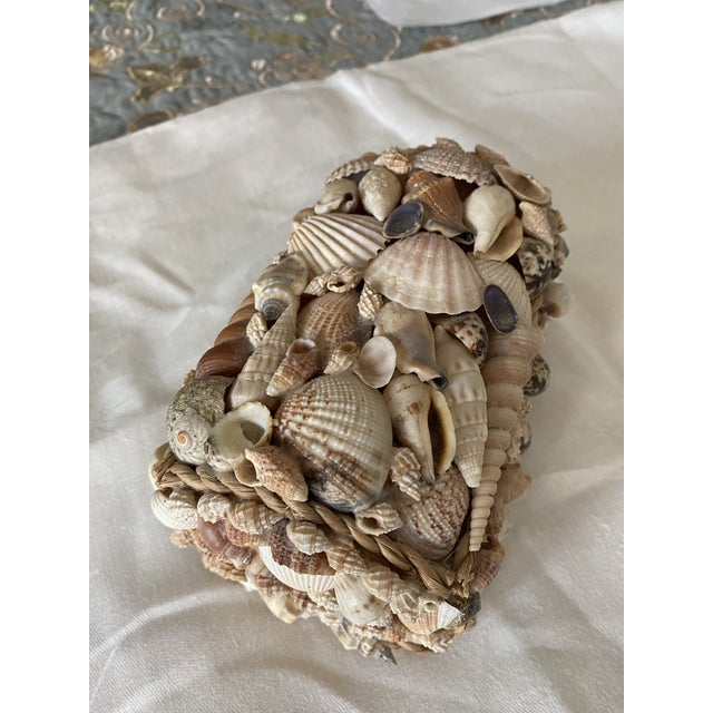 """This is a vintage shell-encrusted hinged box. It lined with dark brown fabric. Dimensions are 4"""" long, 6"""" wide and 4""""..."""