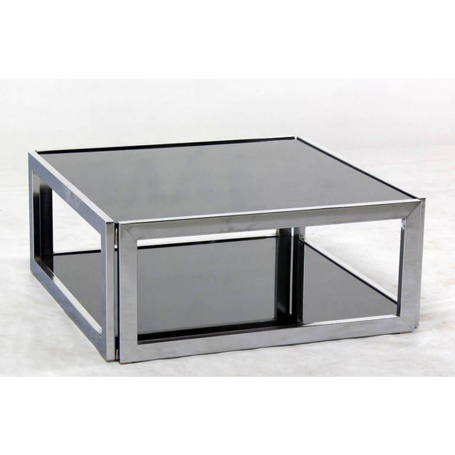Very nice square chrome and smoked glass coffee table in style of M. Baughman.
