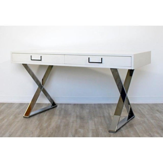 For your consideration is a vivid, white lacquered, campaign desk, on chrome X bases and with chrome pulls, by Milo...