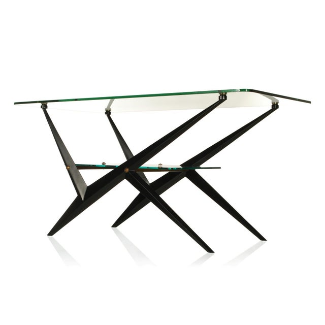This stylish and sophisticated two-tier cocktail table is by the Italian Designer Angelo Ostuni. The striking features of...