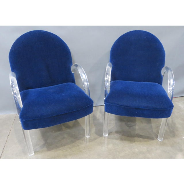 Set of two elegant Lucite chairs by the Pace Collection. These armchairs feature waterfall style Lucite arms which...