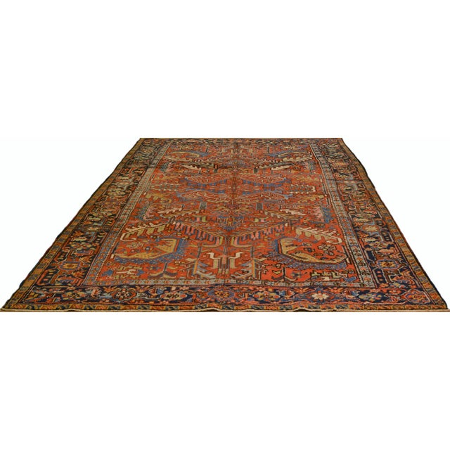 Vintage Persian Heriz hand knotted rug with natural colors and great design.
