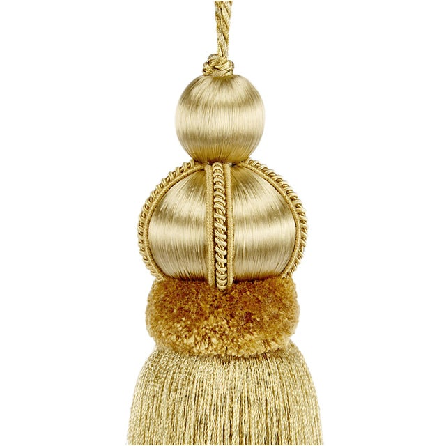 "Gold key tassel with hand cut velvet ruche, decorative gimp and twisted cord detail. Total height including cord - 10""..."