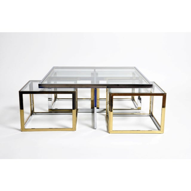 A 1970s era glass-and-brass table with four removable tables. If Sol LeWitt had made furniture it might have come out like...