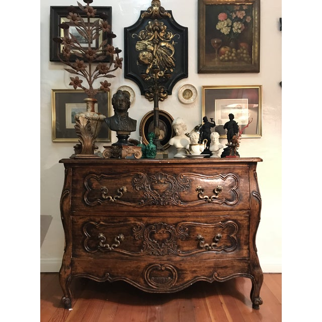 A fine French privincial commode of sophisticated form in well patinated walnut, the fielded paneled drawers with...