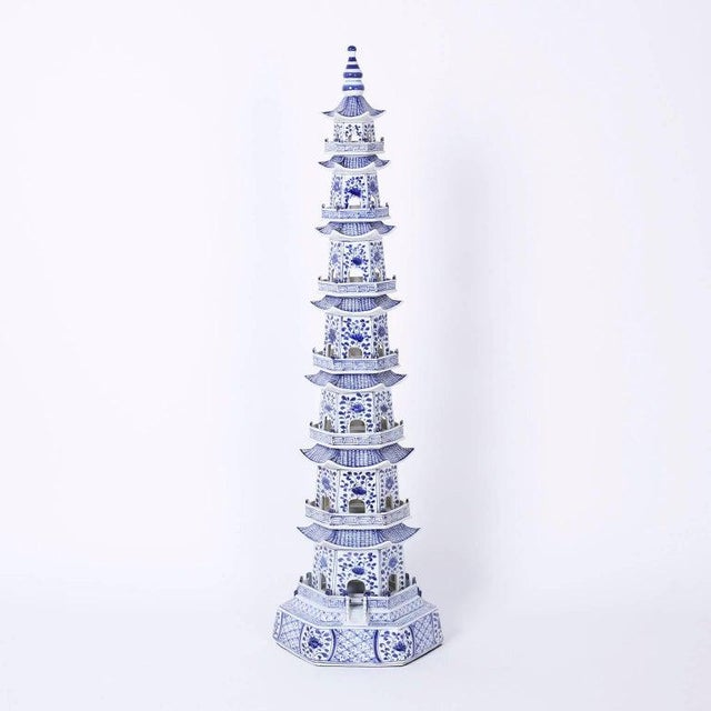Dramatic tall Chinese blue and white pagodas, in the Chinese export style, assembled from eight separate porcelain pieces...