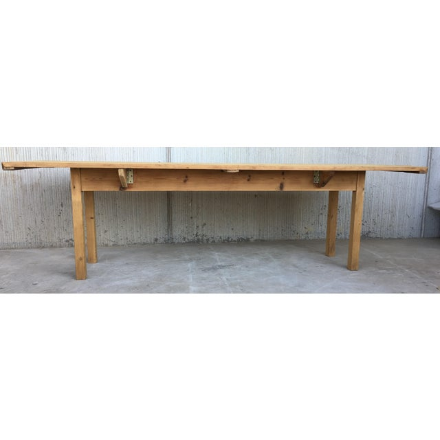 About 20th midcentury large pine drop-leaf country farm table with two leaves Completely restored Very heavy and...
