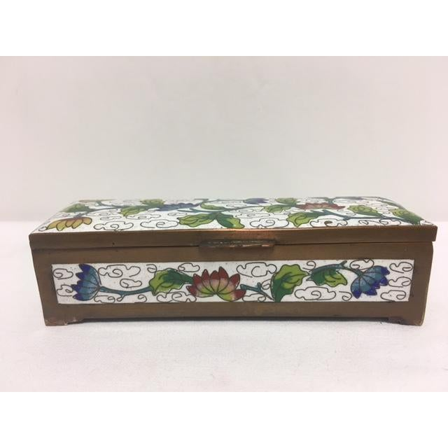 """Beautiful enamel work in this closonne stamp box.. Features three separate compartments. Measures 4.5"""" in width, by 1.5""""..."""