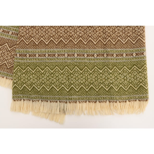 This beautiful vintage throw features green & brown set against creamy white wool and accented with slate gray. From the...