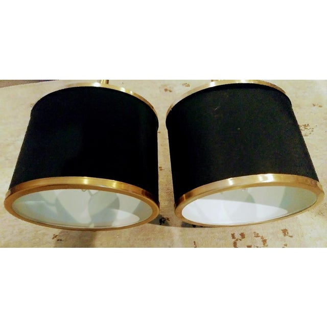 A beautiful pair of black and gold streamlined modern wall sconce lights. The sconces are for hard wiring, they have black...