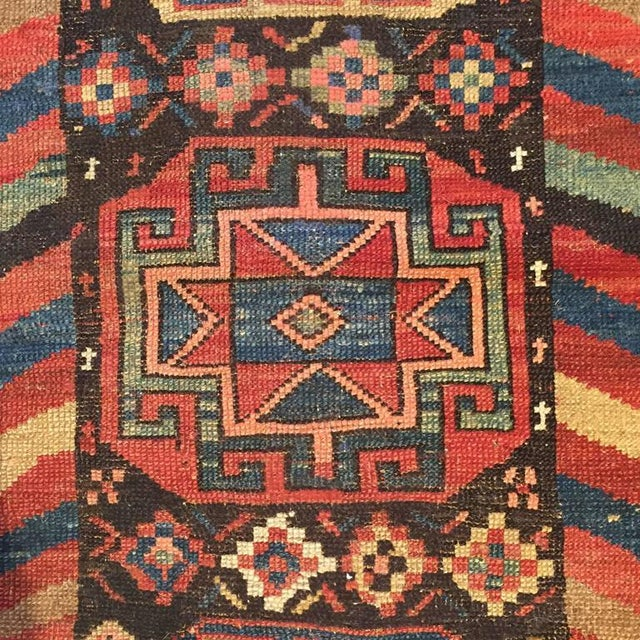 A late 19th century Persian Azeri runner with nine unique and wonderfully detailed multi-colored octagonal medallions with...