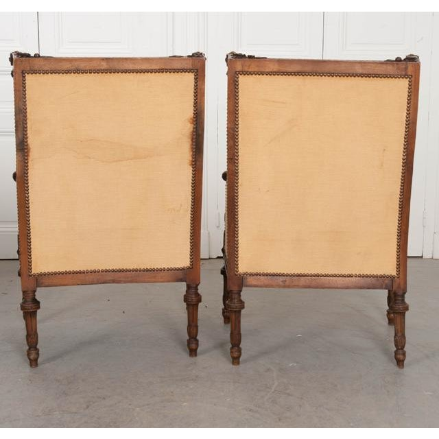 French 19th Century Louis XVI Carved Walnut Bergères - a Pair For Sale - Image 11 of 12