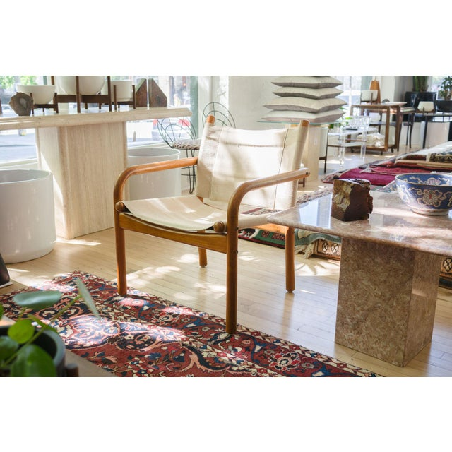 A pair of Mid-Century Danish chairs. style: pair, modern, Scandinavian, sling, lounge, safari chairs material: wood...