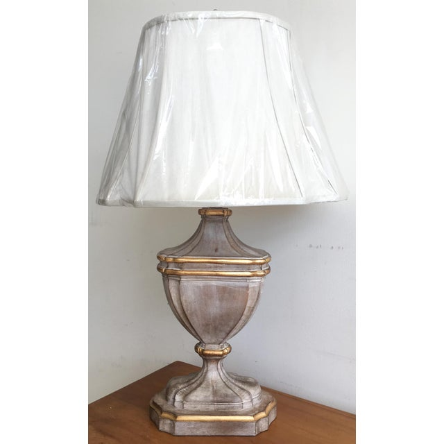 A handsome and never used table lamp made by Bradburn Gallery, featuring a resin cerused wood style urn shaped base...