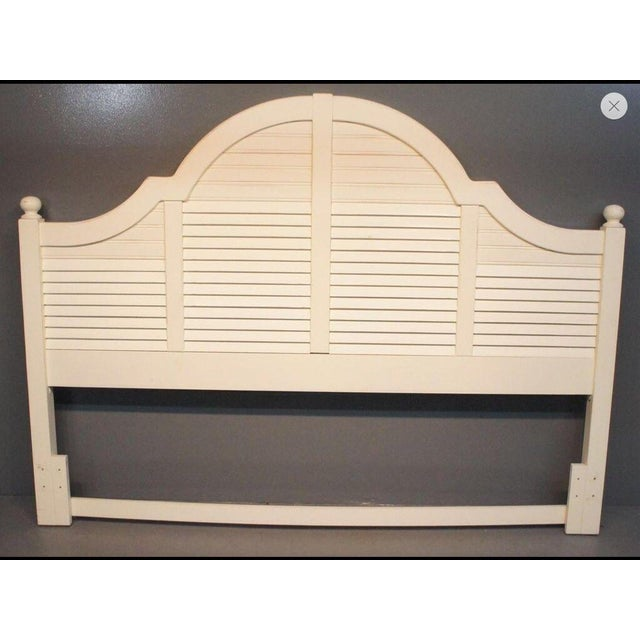 A Lexington Seaside Retreat headboard. The headboard is shutter board with a high, curved top rail. The headboard posts...