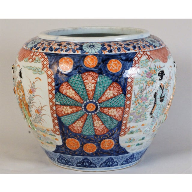 This enchanting hand painted Japanese export porcelain fishbowl is done in the Imari style. Painted with characteristic...