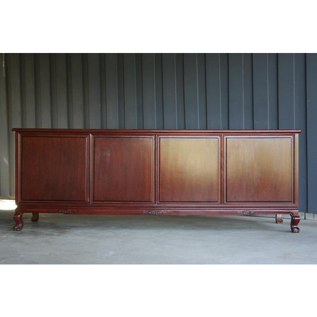 Incredibly crafted Chinoiserie rosewood credenza with brass hardware. Drawers all created with dovetailed construction....
