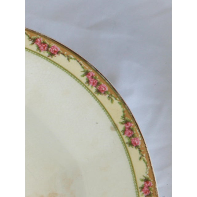 Vintage mottled beige platter with precious tiny pink rose border. Signed Edwin M Knowles, China.