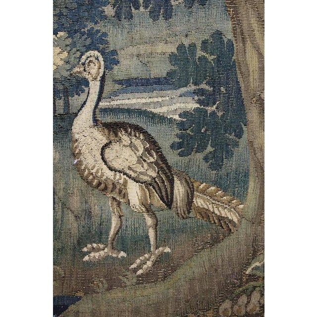 Originally part of a much bigger tapestry, the scene depicting two birds in a landscape.